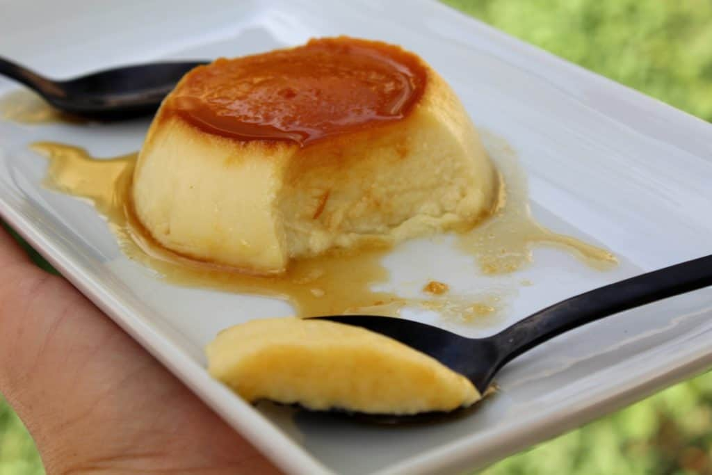 flan with a bite taken out on a spoon