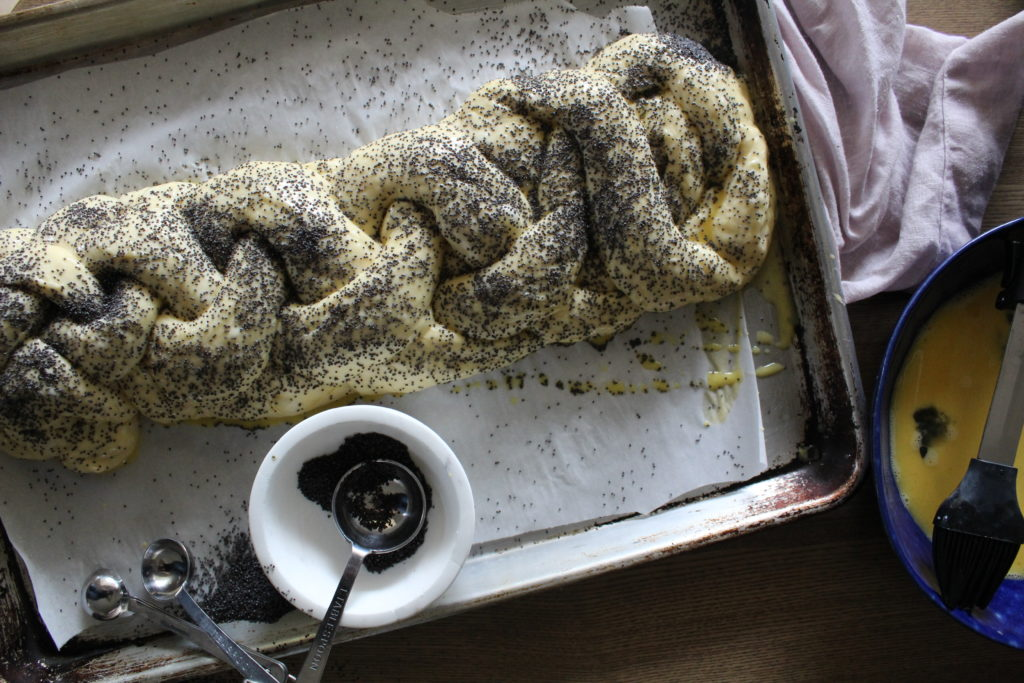 challah dough covered with poppy seeds