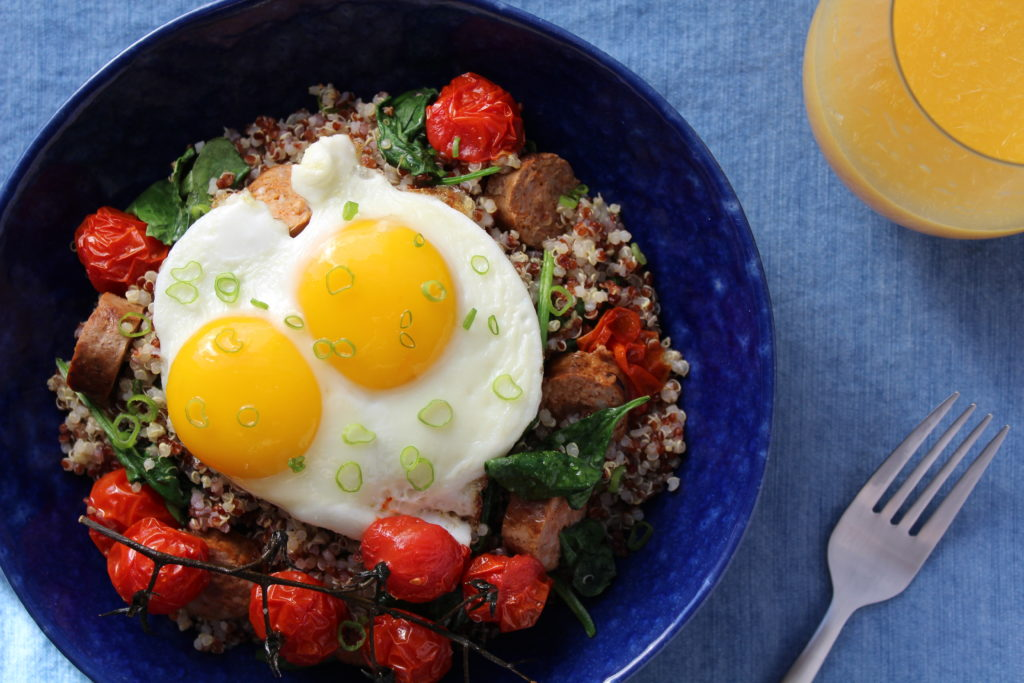 sunny side up eggs over quinoa close up