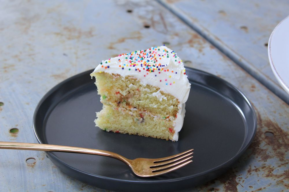 moist gluten free butter cake with white chocolate frosting