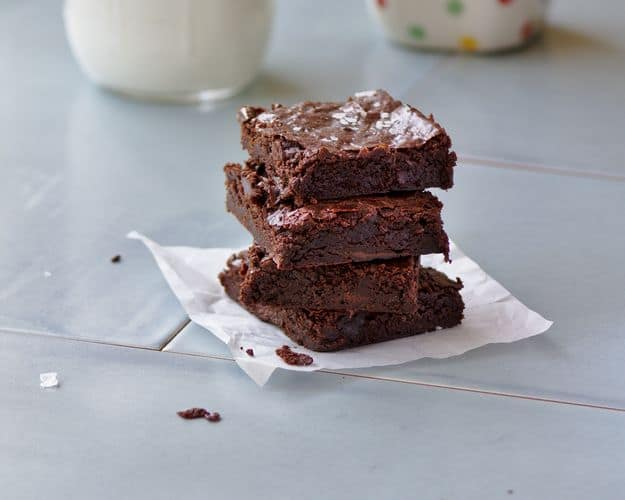 moist brownies stacked on each other