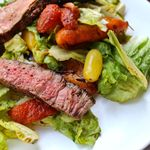 grilled steak with salad and roasted bell pepper