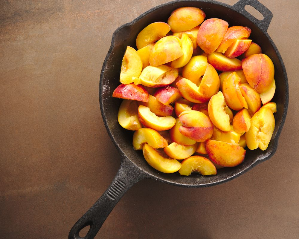 fresh peaches sliced in cast iron skillet