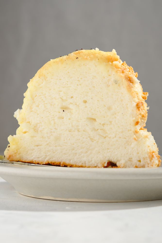 texture of chiffon angel food cake with glaze and poppy seeds