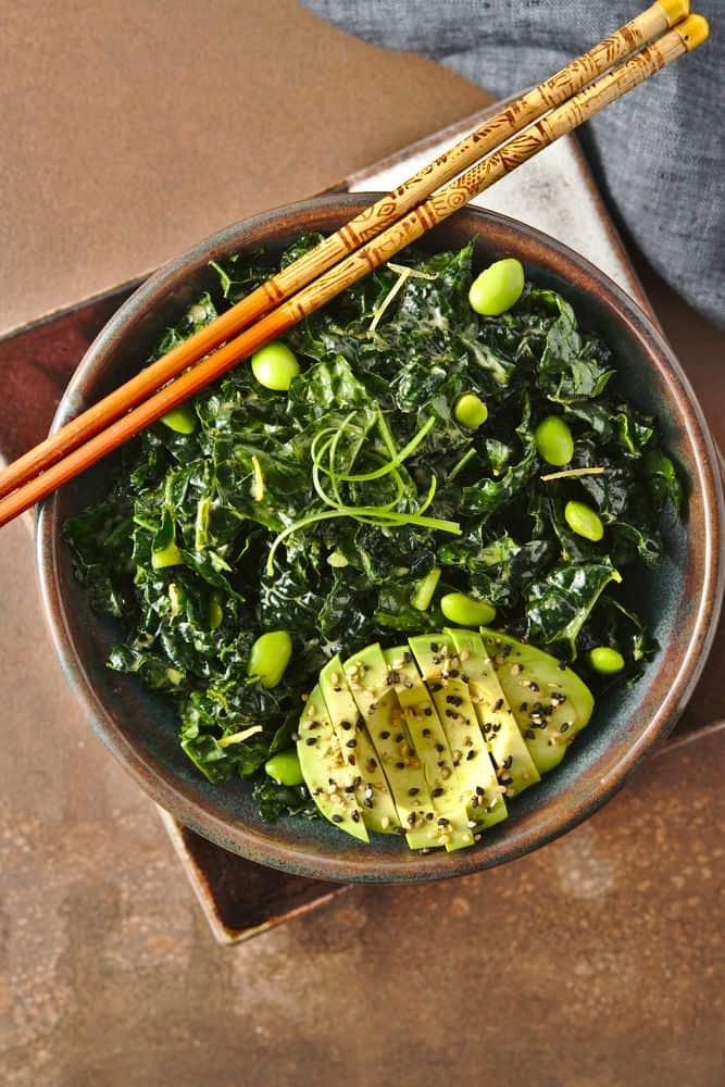 kale salad, ginger umami vinaigrette, edamame, scallions, sesame seeds, avocado