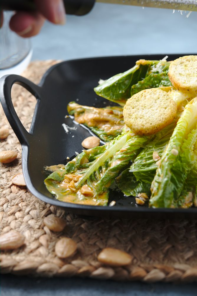caesar salad with marcona almonds and croutons