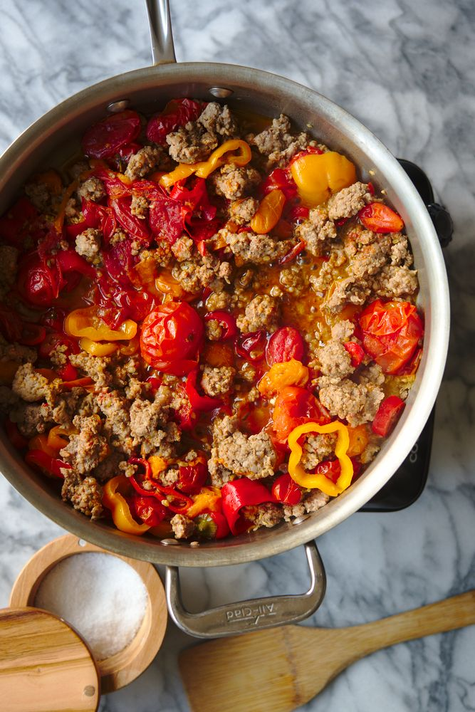ground pork simmering in tomato and pepper sauce with fennel