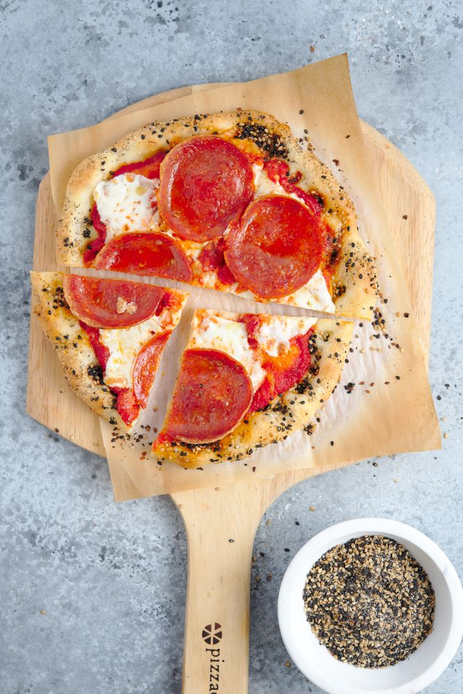 thin crust pizza with mozzarella, pepperoni, and sesame seed crust