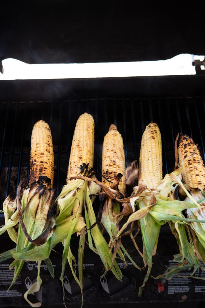charred corn on the grill