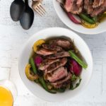 duck breast over summer vegetables in green onion broth
