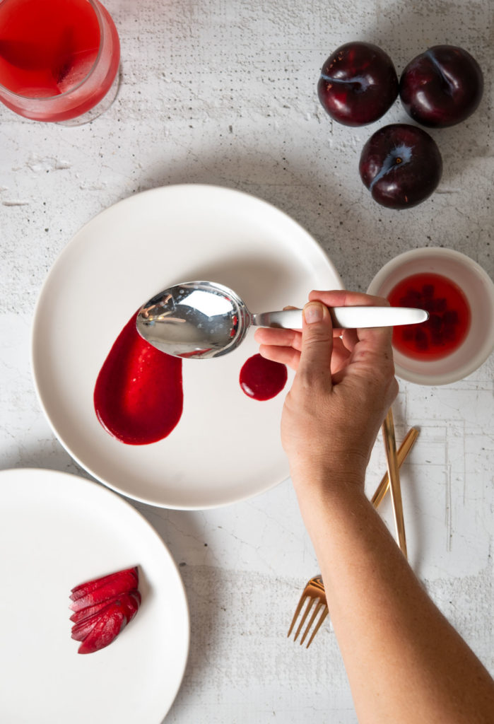 swirling the plum sauce with a spoon