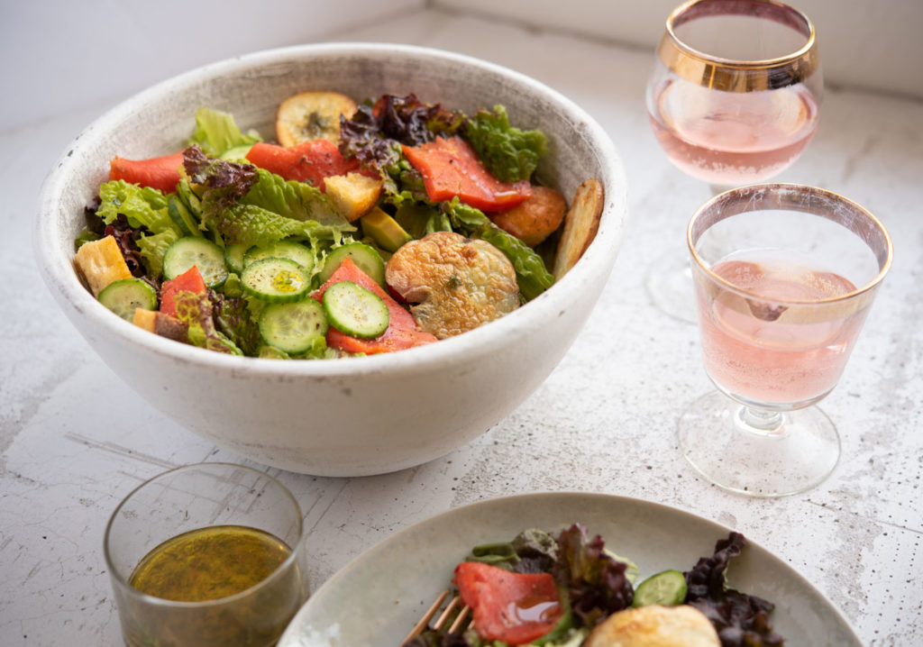 salmon salad in a bowl with wine