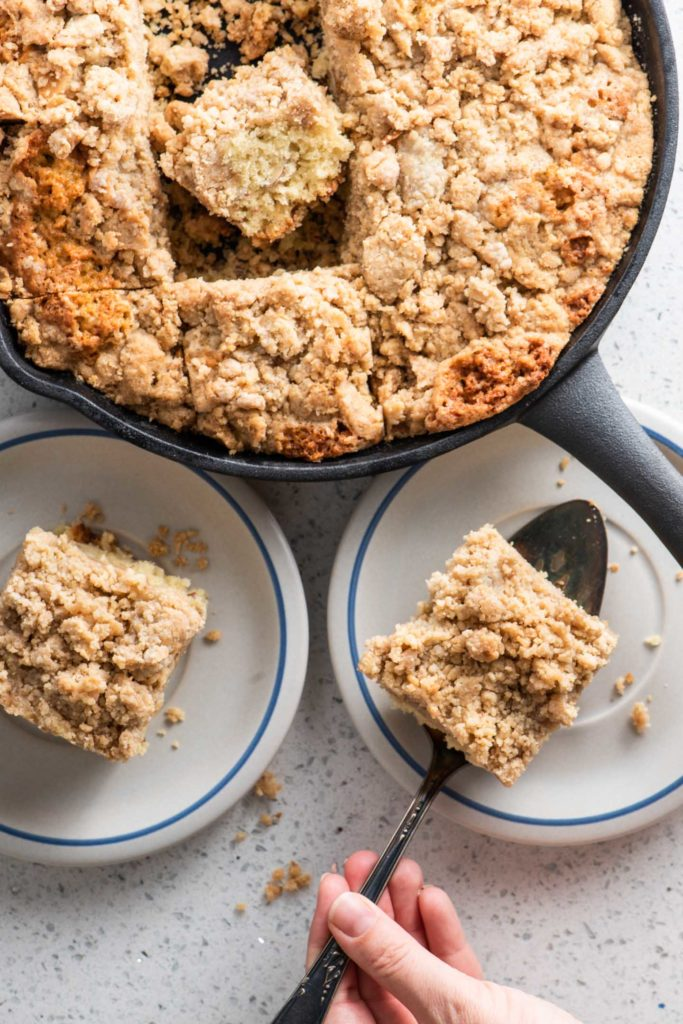 streusel chai coffee cake baked in a cast iron skillet