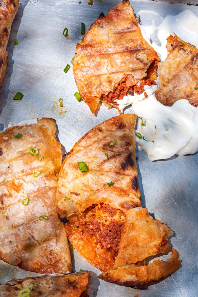 chorizo baked tacos grilled until crispy with sour cream and cheese
