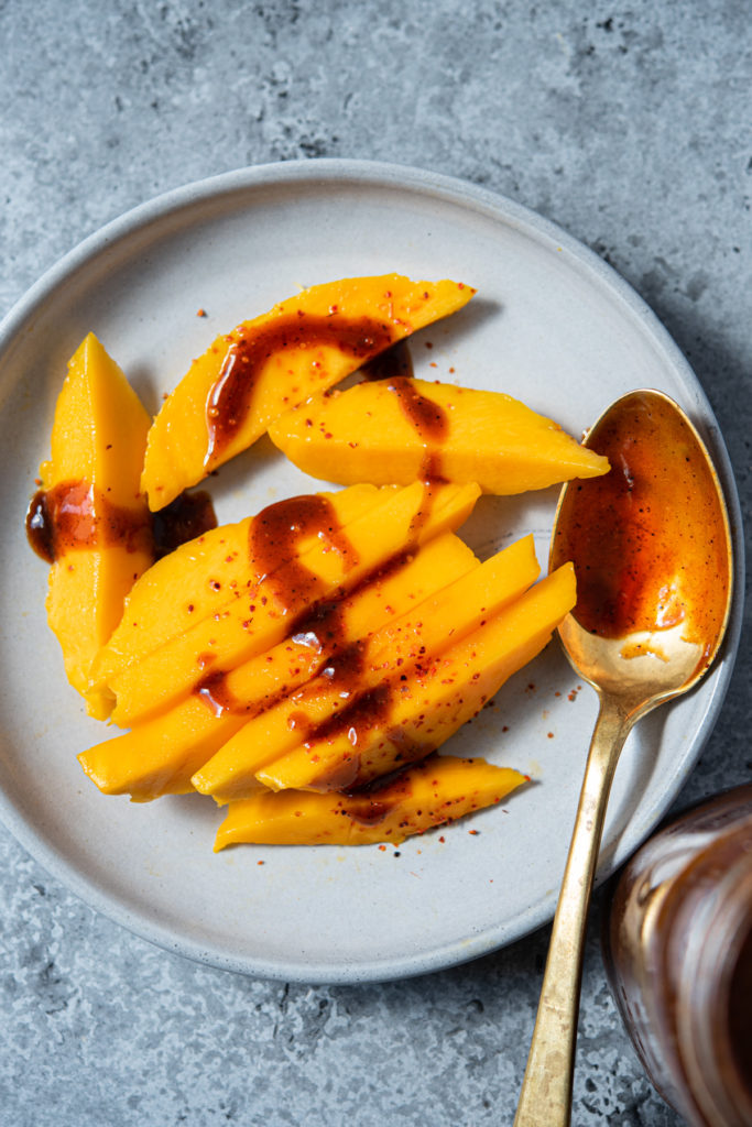 chamoy condiment with fresh mango and tajin
