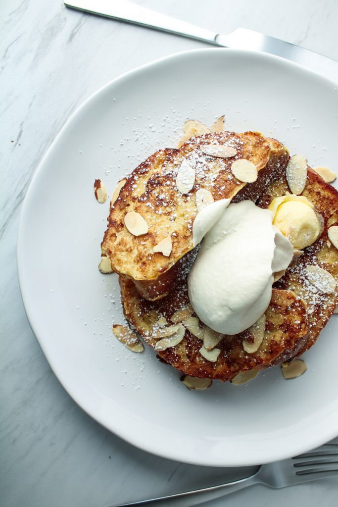 challah french toast, whipped cream, maple syrup, and almonds