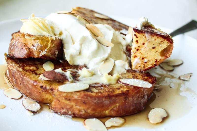 french toast with almonds and maple syrup