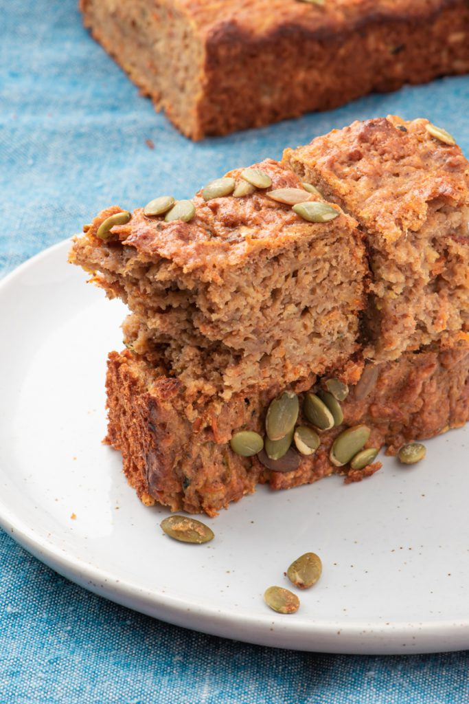 carrot-parsnip-zucchini bread sliced and stacked on a plate
