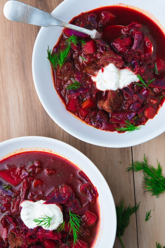 bowl of borscht stew with sour cream and dill