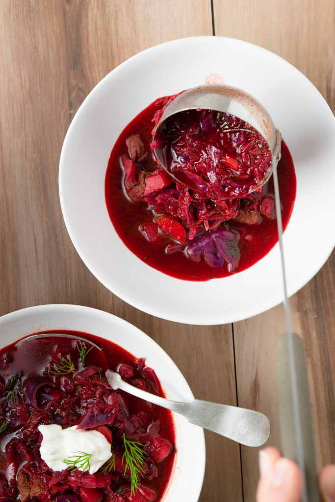 borscht (borsch) beet stew with lamb, dill, cabbage, and sour cream