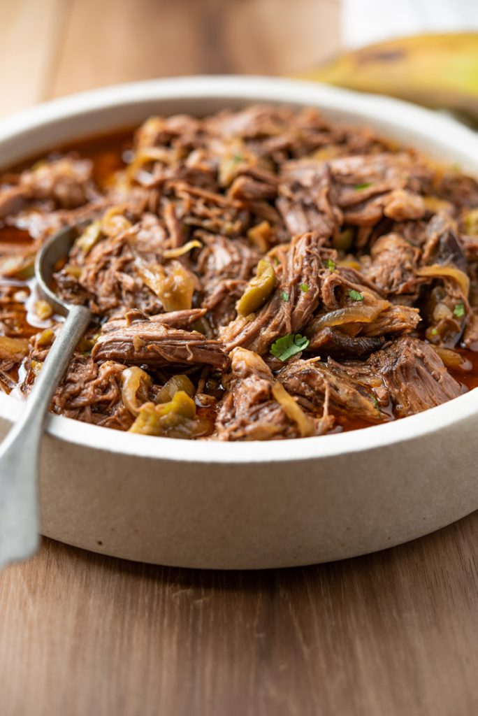 ropa vieja - cuban shredded beef with olives in tomato broth