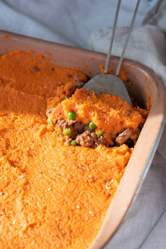 sweet potato shepherd's pie with lamb and beef in casserole dish