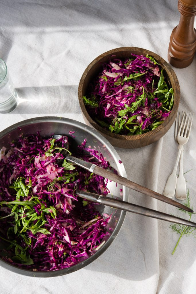 cabbage and fennel salad mixed in a bowl