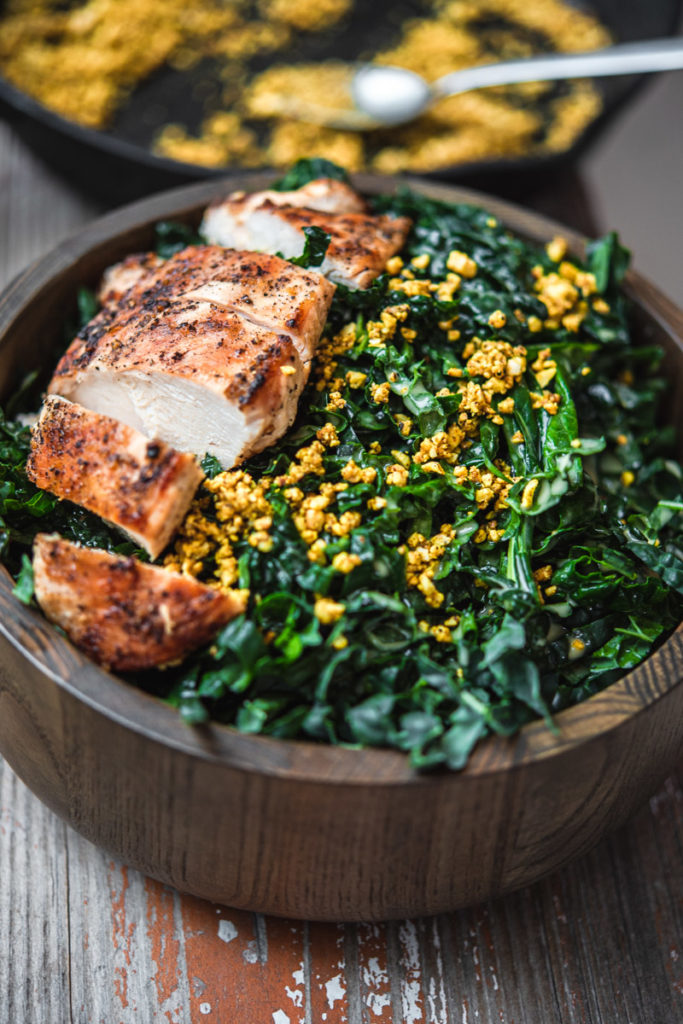 tuscan kale, lemon vinaigrette, grilled chicken breast, toasted cashews with turmeric