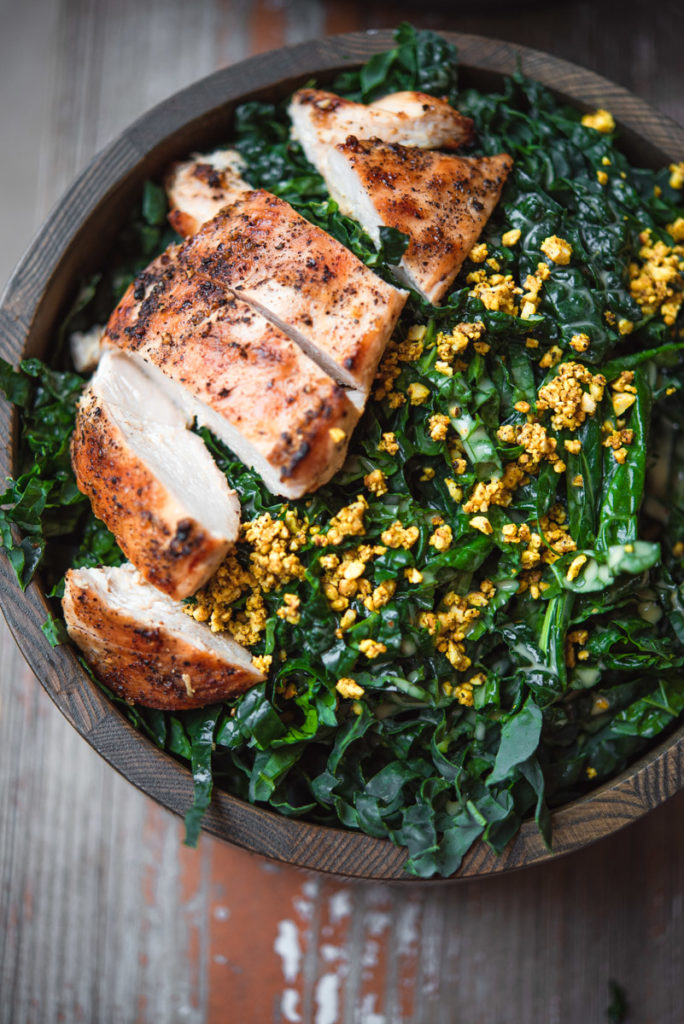 tuscan kale salad with lemon garlic dressing grilled chicken and turmeric cashew crumble