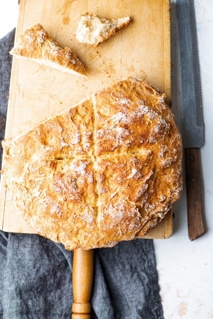 crusty irish soda bread on cutting board