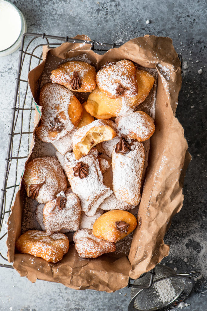 fried beignets with nutella and powdered sugar