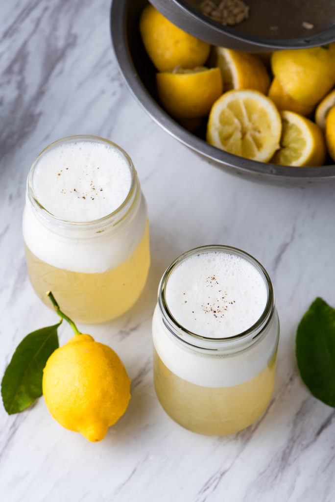 homemade lemon sodas with salt, sparkling water, lemon juice, and cane sugar