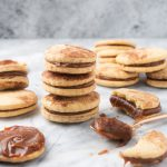alfajores sandwich cookies with dulce de leche