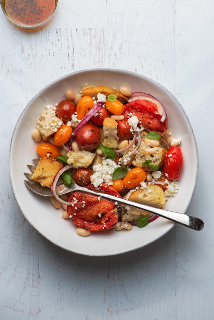 heirloom cherry tomato panzanella salad with oil and vinegar