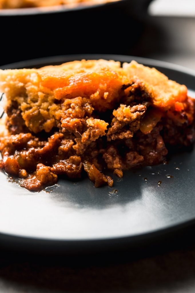 a big scoop of tamale pie with beef and cheese