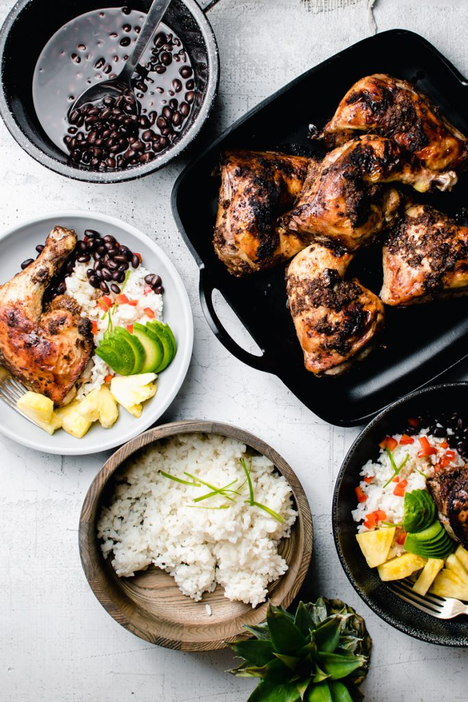 baked chicken quarters with jamaican jerk sauce, rice, and beans