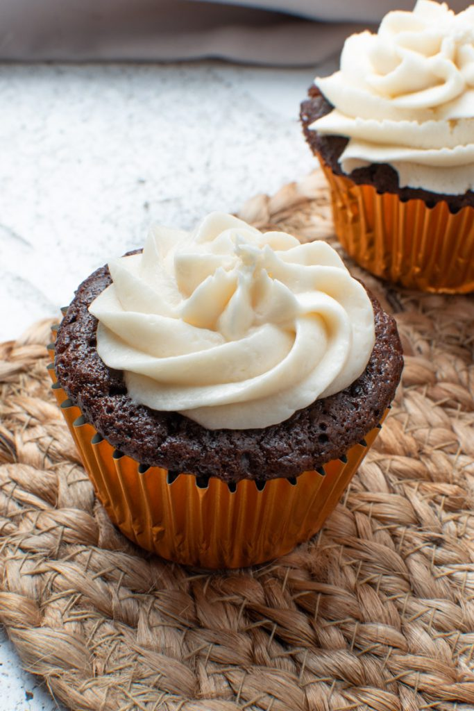 chocolate cupcakes with almond extract and vanilla frosting