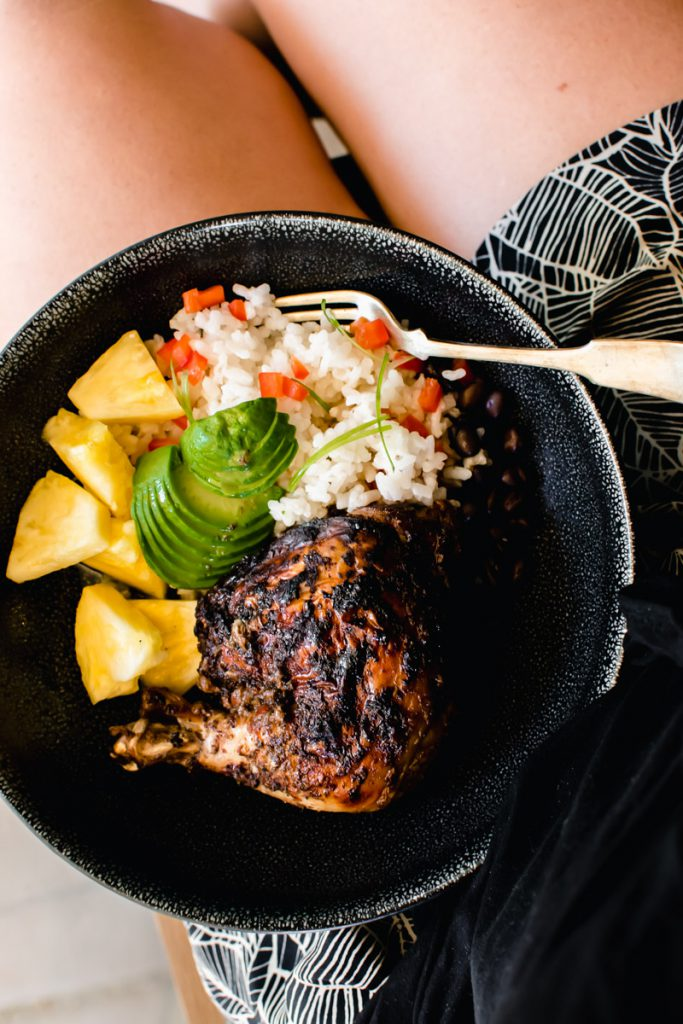 jerk chicken with avocado, rice, and pineapple