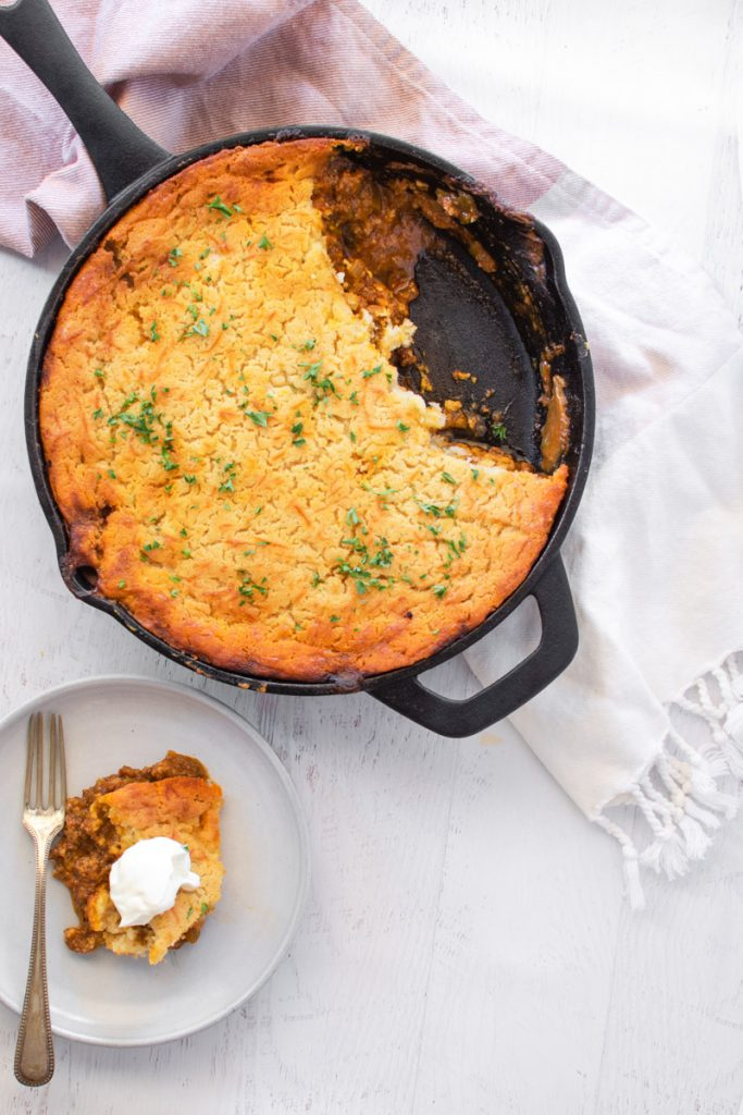 tamale pie baked in a cast iron skillet