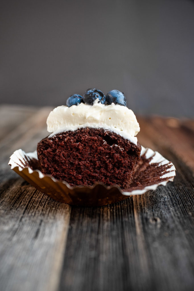 gluten free chocolate cupcake with white frosting