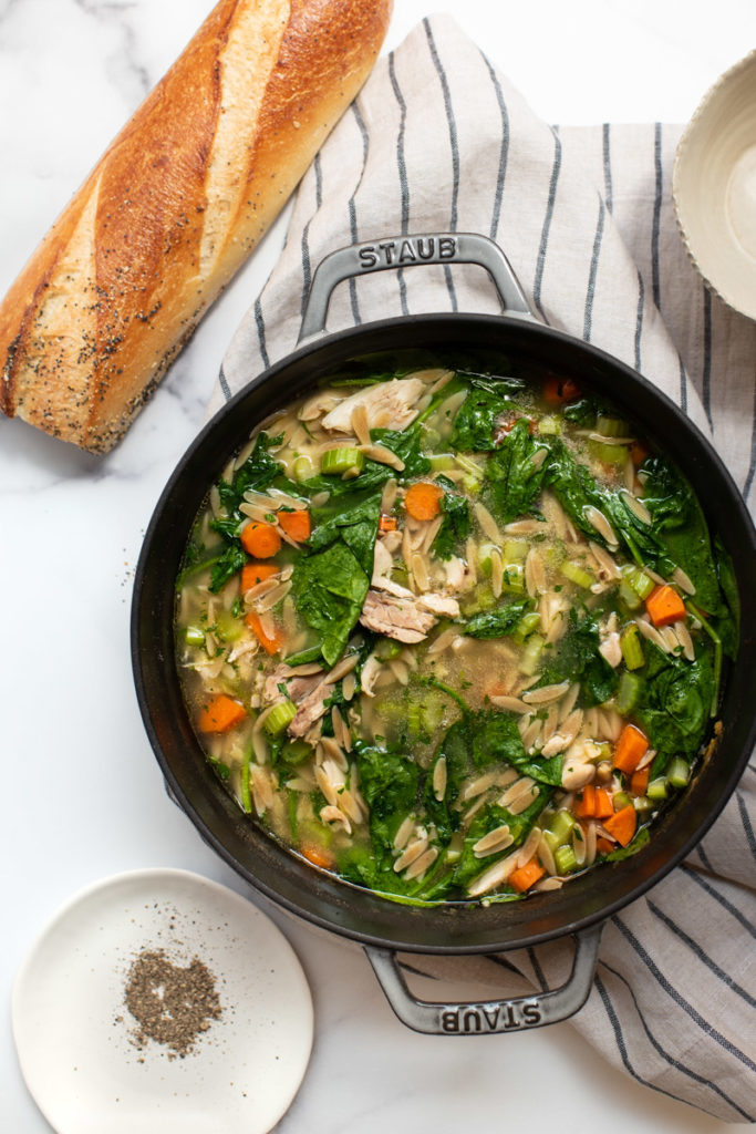 lemon chicken orzo soup in a Dutch oven