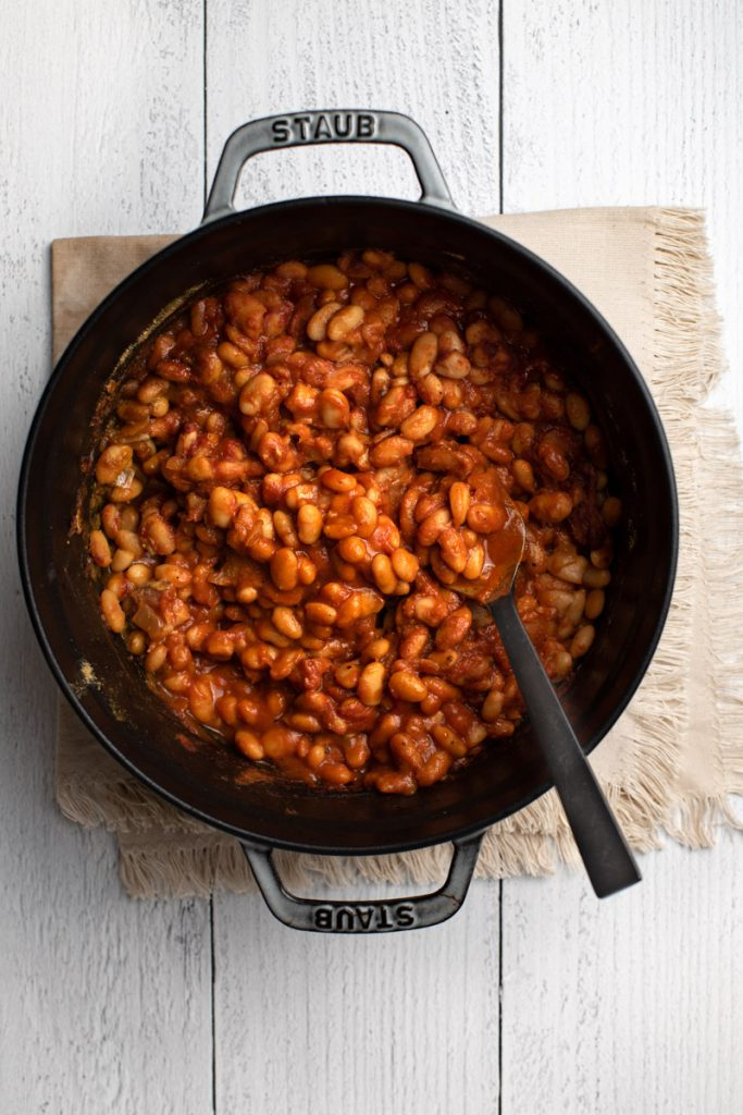 maple bacon baked northern beans in a Dutch oven