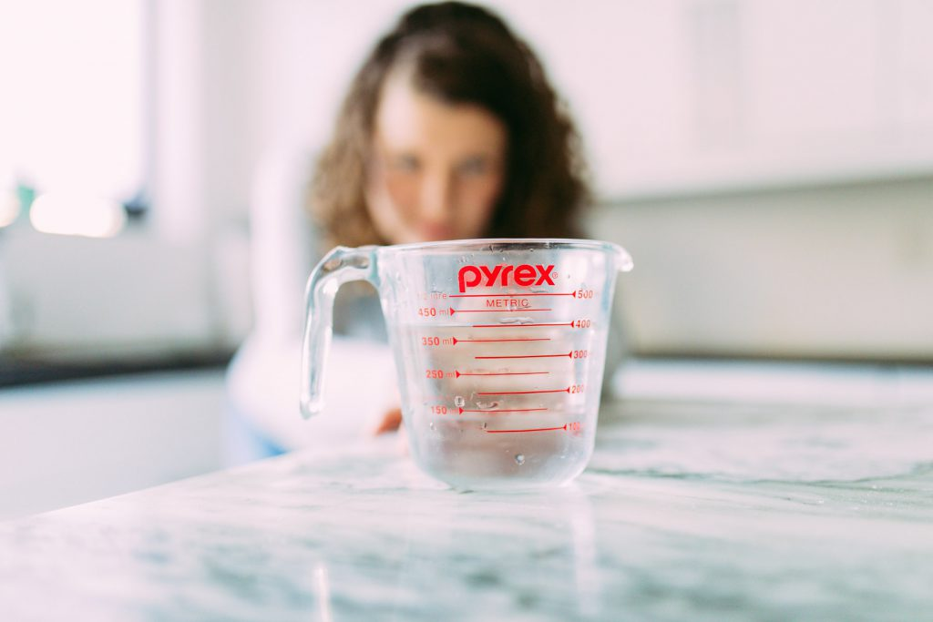 measuring cup with water
