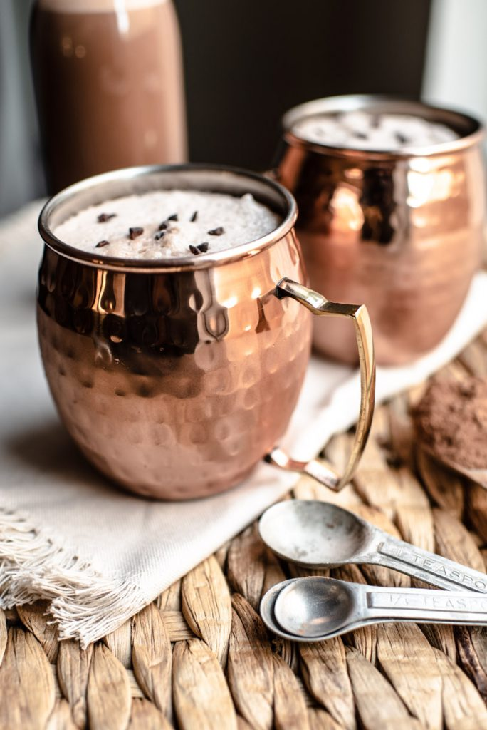 chocolate coconut milk blended with ice and served in Moscow mugs