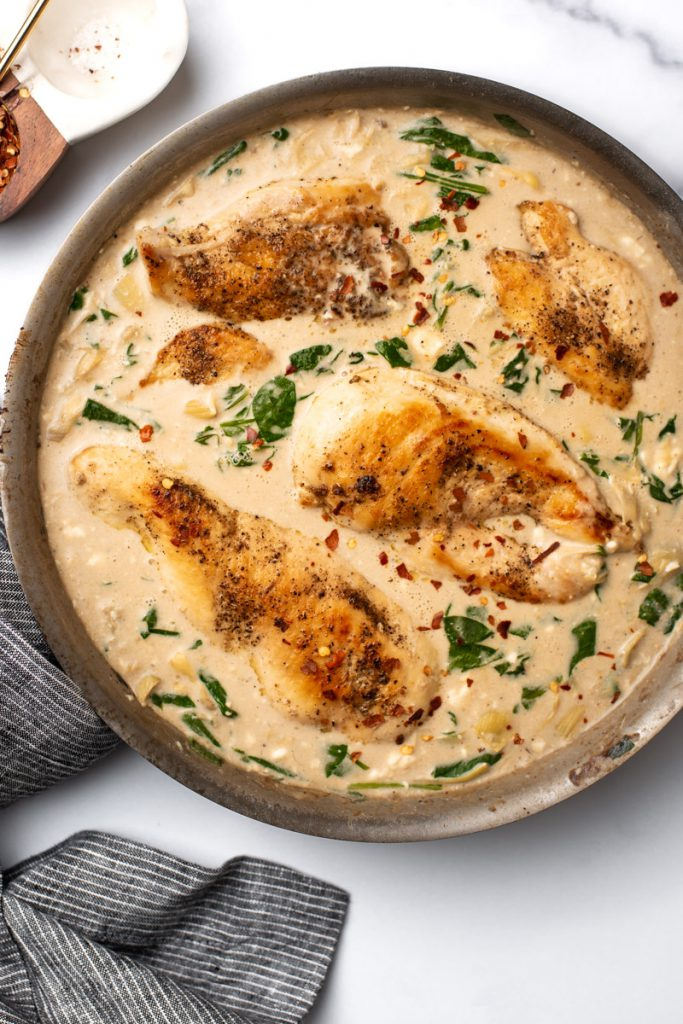 skillet chicken breast pan-seared in a creamy artichoke sauce