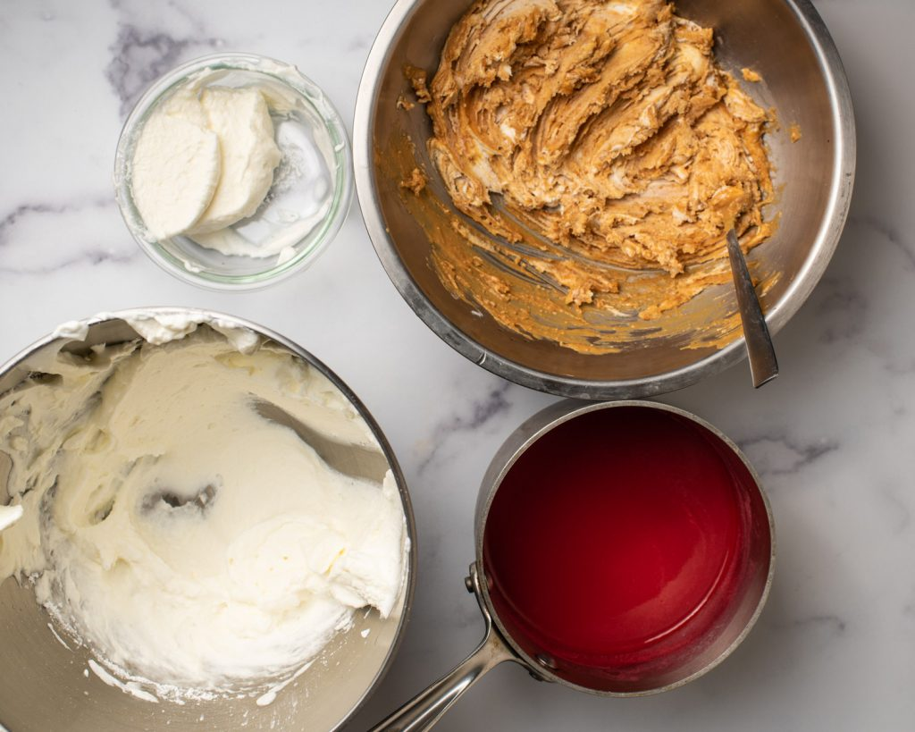 bowl of whipped cream, bowl of peanut butter and cream cheese, and raspberry coulis