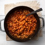 maple bacon baked beans in Dutch oven